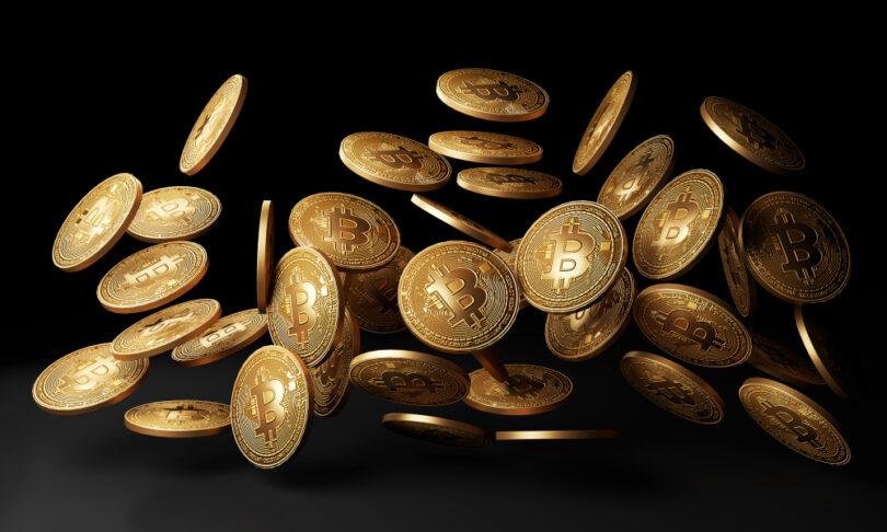 golden bitcoins drop black background 3d rendering